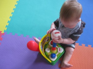 Learning to play baseball... or eat a baseball, anyway.