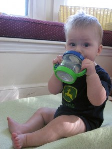 Loves his sippy cup!