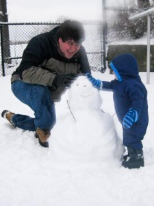 Making a snowman with Daddy