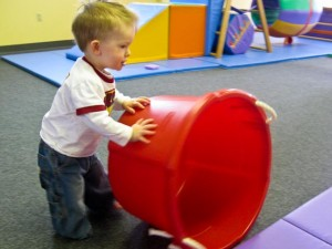 Rolling a bucket around at Gymboree