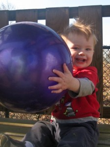 With giant purple ball
