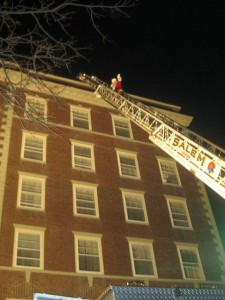 Santa then climbs down the looooooong fire truck ladder to the crowd of very excited children below.
