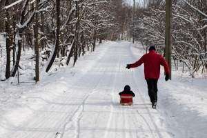 It's fun to go sledding with Granddad!