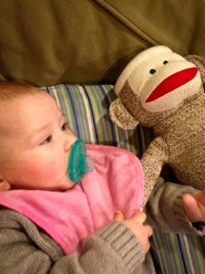 Resting with a sock monkey